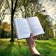 book, hand and forest - Ethics thinking on world days and reading in a digital age